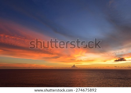 sunset sky with clouds explosion and golden light at ocean ,long exposure