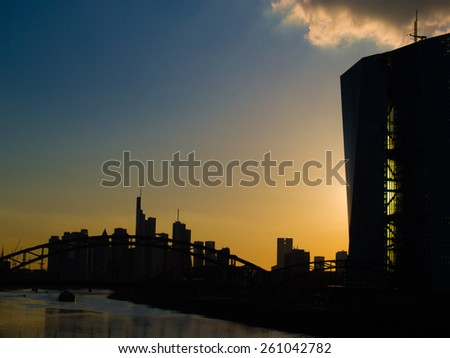 Sunset, skyline and the European Central Bank Headquarters, Europaeische Zentralbank,  in Frankfurt, Germany - stock photo