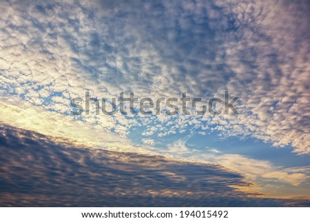 Sunset / sunrise in the sky with clouds - stock photo