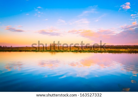 Sunset, sunrise over river. Russian nature background - stock photo