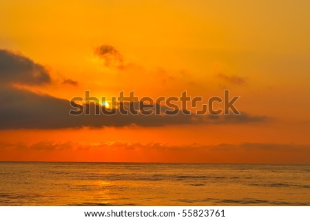 sunset/sunrise over the sea - stock photo