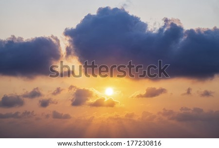 sunset / sunrise with clouds, light and other atmospheric effect - stock photo