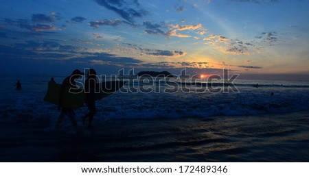 sunset surf 1 - stock photo