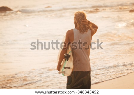 Sunset. Surfer - stock photo