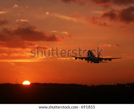 Sunset take-off - stock photo