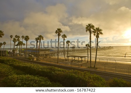 Sunset Train at San Clemente Pier during Summer - stock photo