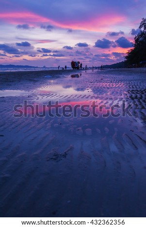 Sunset twilight over sea beach at Rayong province, Thailand - stock photo