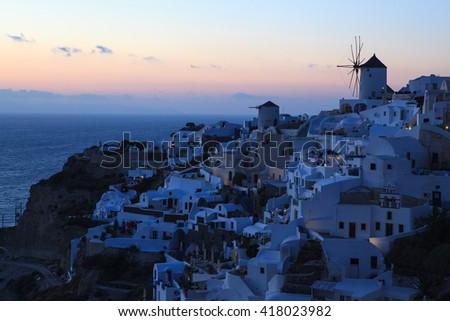 Sunset view from Oia village,Santorini island,Greece - stock photo
