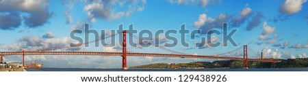 sunset view of old Salazar bridge, now known as April 25th in Lisbon, Portugal (panoramic picture) - stock photo