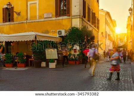 Sunset view of old street in Trastevere in Rome, Italy - stock photo