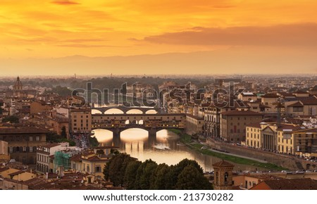 Sunset view of Ponte Vecchio over Arno River in Florence, Italy - stock photo