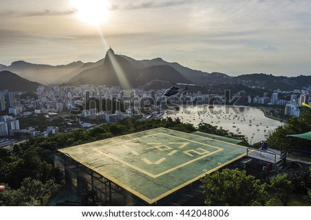 Sunset view of Rio de Janairo, Brazil with helicopter - stock photo