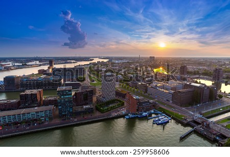 Sunset View of Rotterdam's Harbor from the Euromast Tower, Netherlands. - stock photo