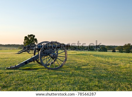 Sunset view of the old cannons in a line at Manassas Civil War battlefield where the Bull Run battle was fought. 2011 is the sesquicentennial of the battle