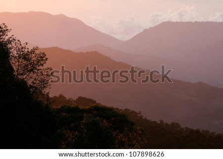 Sunset View over Coffee Plantations in a Costa Rica Valley. From Mirador de Quetzales, Costa Rica, Central America. - stock photo
