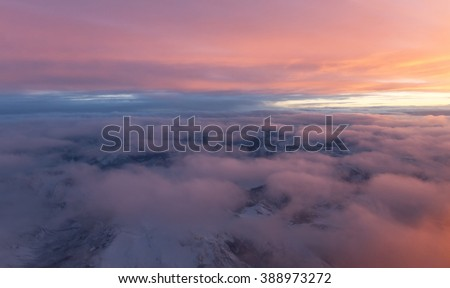sunset viewed from an airplane over Canadian Rocky Mountains  - stock photo