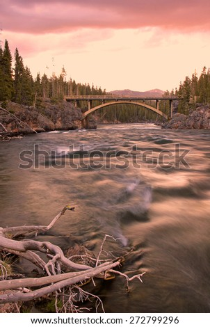 Sunset With a bridge over the Madison River, Yellowstone, Wyoming, USA. - stock photo