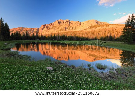 Sunset with a pond in the Uinta Mountains, Utah, USA. - stock photo