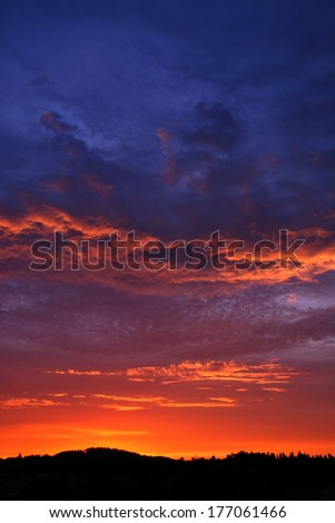 Sunset with alpenglow vertically - stock photo