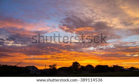 Sunset with beautiful blue sky. - stock photo