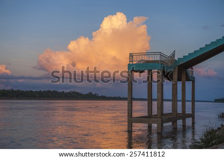 Sunset with big cloud over Kong river, Thailand. - stock photo