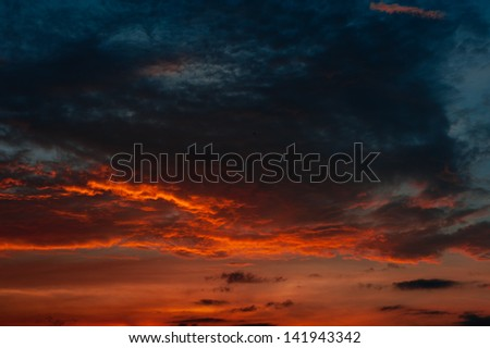 sunset with black clouds