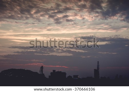 Sunset with clouds and light rays  other atmospheric effect for use as a background image and as an illustration.
