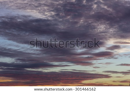 sunset with clouds the sky is in beautiful dramatic color - stock photo