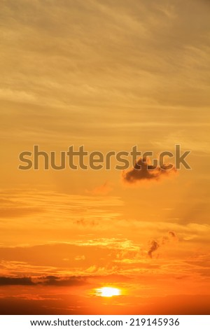 sunset with clouds  the sky is in beautiful dramatic Gold color - stock photo