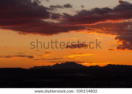 Sunset with mountains silhouette