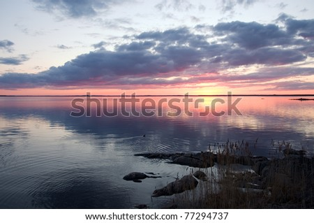 Sunset with overcast sky - stock photo