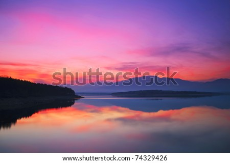 sunset with reflection - stock photo