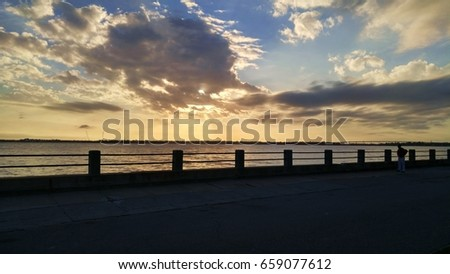 Sunset with Spectacular Clouds Along the Low Battery in Charleston, SC