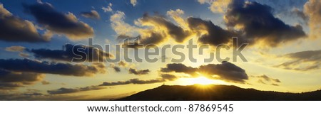 sunset with stormy sky and clouds - stock photo