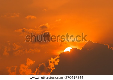 Sunset with sun rays and clouds  - stock photo