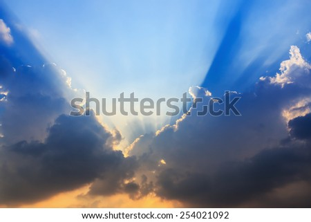 Sunset with sunlight sun rays from clouds - stock photo