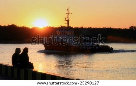 sunset with to girls at the port key - stock photo