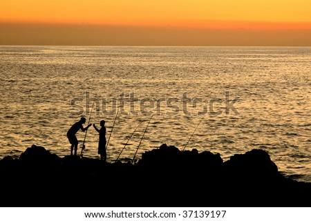 Sunset with two fishermen on Maui a Hawaiian island