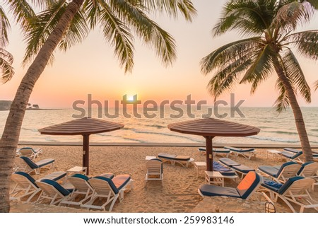 sunset with umbrellas and beach chairs on pattaya city Thailand. - stock photo