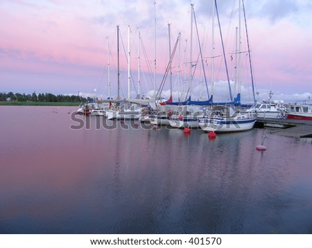 Sunset with yachts - stock photo