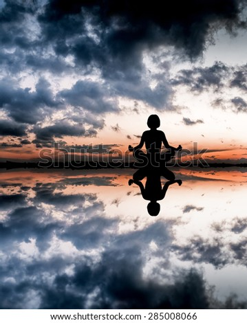 Sunset yoga woman on sea coast. - stock photo