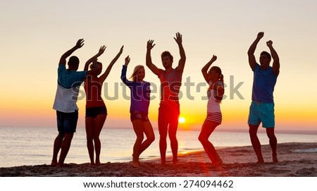 Sunset, youth, group. - stock photo