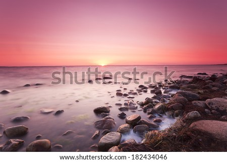 Sunsetting over the baltic sea, beautiful summer scene - stock photo