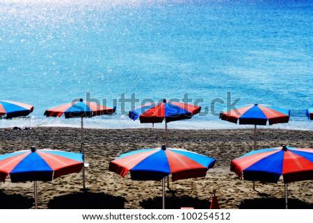 sunshade at the beach on a very sunny day - stock photo