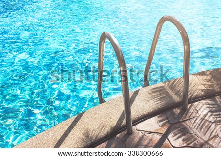 sunshine and clear water of swimming pool - stock photo
