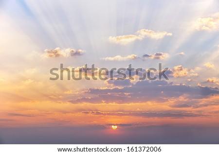 Sunshine beam and cloud before sunset - stock photo