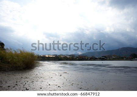 sunshine over pond without water in kyoto, japan - stock photo