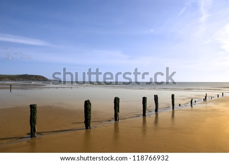 sunshine over the beach breakers in Youghal county Cork Ireland on a summers day - stock photo