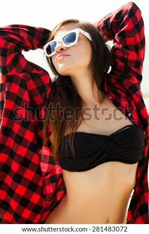 Sunshine portrait of summer stylish woman wear fashion reflect sunglasses,looking up to the sky.Outdoor lifestyle summer stunning fit woman.Silhouettes of young teen girl Joyful her summertime - stock photo