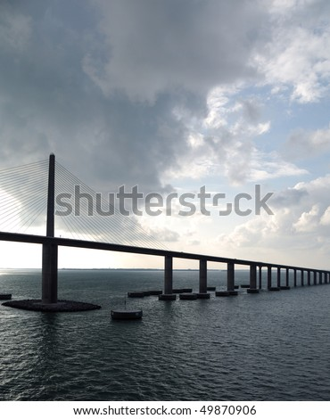 Sunshine Skyway Bridge - spanning Tampa Bay south of St. Petersburg, FL - as storm clouds clear - Cable Stay type bridge - stock photo